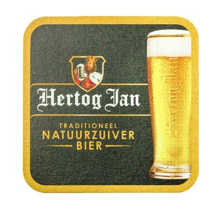 NETHERLANDS - LUNTEREN - JULY 17, 2017: Hertog Jan beer mat. Isolated on white background.