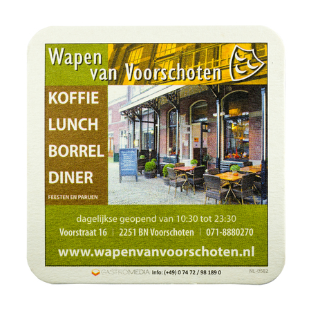 NETHERLANDS - LUNTEREN - JULY 17, 2017: Beer mat advertising The Wapen van Voorschoten cafe for coffee, lunch, drink, dinner in Voorschoten. Isolated on white background. Redactioneel