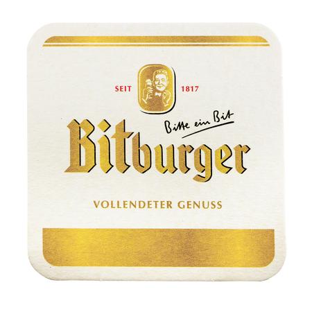 NETHERLANDS - LUNTEREN - JULY 17, 2017: Bitburger beermat. Isolated on white background