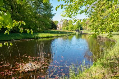 View in estate Duivenvoorde with castle Duivenvoorden in Voorschoten, Netherlands.
