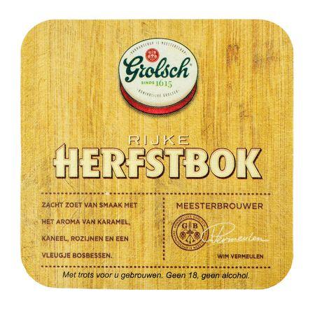 NETHERLANDS - LEIDSCHENDAM - MARCH 11, 2018: Grolsch Herfstbok beermat. Isolated on white background.