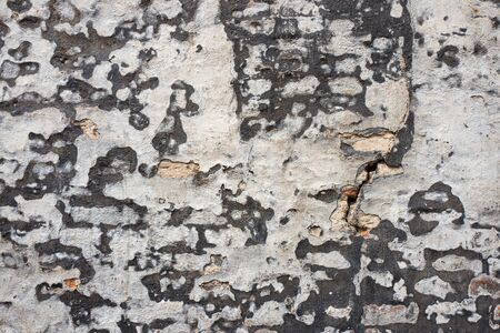 Old plastered wall in close-up.