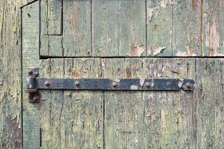 Old door rusty hinge in close-up.