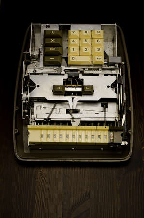 The inside of a Contex-10 mechanical calculator; also called a Comptometer. Cover removed.