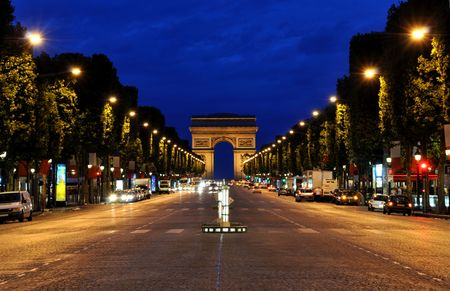 The Champs-E�lys�es and the Arc de Triomphe in Parisduring the night photo