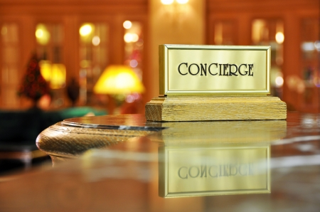 Concierge sign and its reflection in a luxury hotel