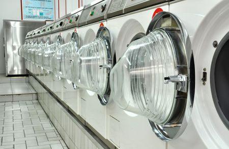 launderette: A laundromat in self service with all doors open Stock Photo