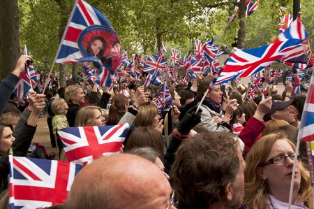 by catherine: London, England - April 29, 2011 - The crowd on the Mall waving Union Jack flags during the Royal Wedding