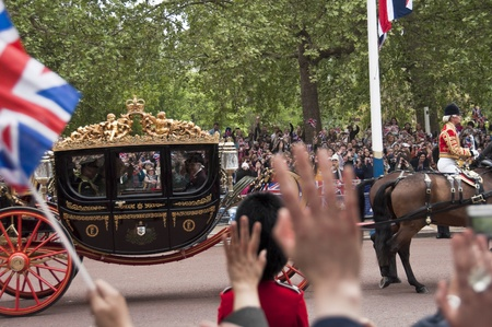 London, England - April 29, 2011 - A horse carriage on the Mall at Prince william and Kate Middleton wedding
