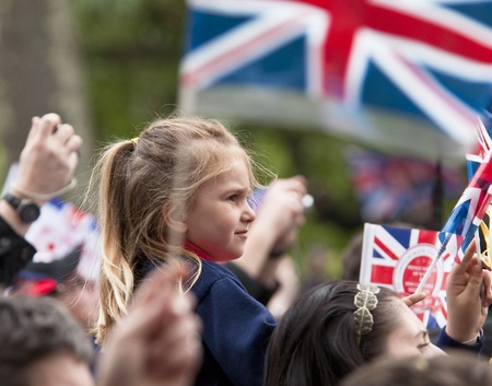 London, England - April 29, 2011 - A young girl among the public at Prince William and Kate Middleton wedding Stock Photo - 9532430