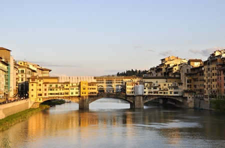 sienna: The Ponte Vecchio and the Arno river at sunset