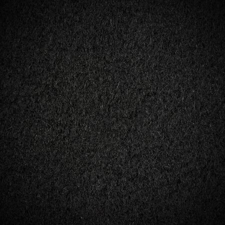 fleece fabric: Black wool texture with vignette Stock Photo