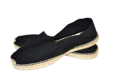 Black pair of espadrilles on a white background