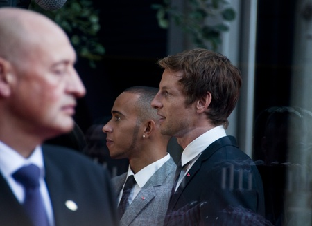 LONDON, UK - JUNE 21: Jenson Button and Lewis Hamilton at the official opening of the new McLaren showroom on Knightsbridge on June 21, 2011 in London, UK Stock Photo - 9754361