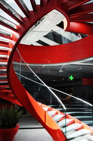 spiral staircase: Red spiral staircase in an airport