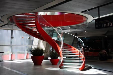 banister: Red spiral staircase in an airport