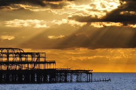 brighton beach: The West Pier in Brighton at sunset, UK Stock Photo