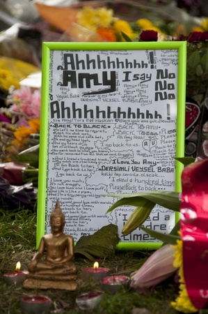 homage: LONDON - JULY 27: Her fans pay tribute to Amy Winehouse in front of her house on Camden square, on July 27, 2011 in London. Amy Winehouse died aged 27 on Saturday, July 23. Editorial