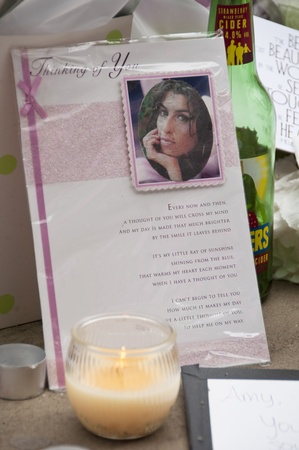 grammy: LONDON - JULY 27: Her fans pay tribute to Amy Winehouse in front of her house on Camden square, on July 27, 2011 in London. Amy Winehouse died aged 27 on Saturday, July 23. Editorial