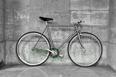 Vintage fixed gear bicycle, black & white picture, green chain photo