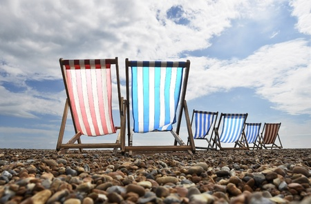 pebble: Empty deckchairs on brighton beach Stock Photo