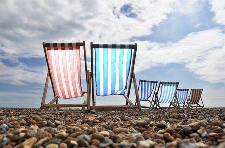 brighton beach: Empty deckchairs on brighton beach Stock Photo