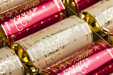 crackers: Golden and red Christmas crackers Stock Photo