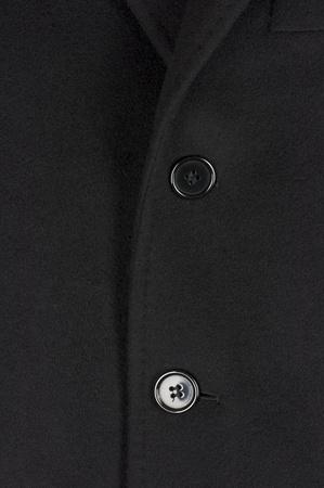 buttonhole: Black woolen coat closeup, male fashion