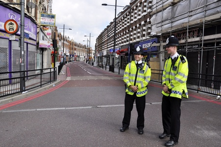 LONDON _ AUGUST 09: Clapham Junction area is sacked after the third night of riots, on August 09, 2011 in London. Riots start spreading in London after Mark Duggan was shot dead by the police. Stock Photo - 10186191