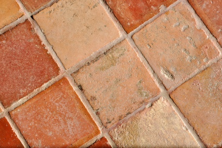 A nice and old traditional brown tile floor photo