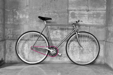 Vintage fixed-gear bicycle with a pink chain photo