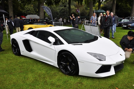 publicly: LONDON - SEPTEMBER 04: A Lamborghini Aventador LP700-4 at Chelsea AutoLegends, on September 04, 2011 in London. The Aventador was publicly unveiled at the Geneva Motor Show on February 2011.