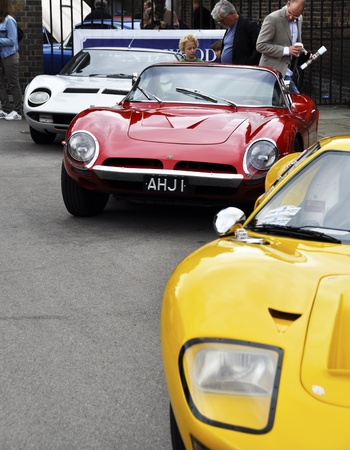LONDON - SEPTEMBER 04: A Ford GT40, a Bizzarrini 5300GT Strada and a Lamborghini Miura at Chelsea AutoLegends, on September 04, 2011 in London.