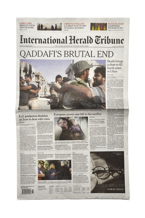 regime: LONDON - OCTOBER 20: Gaddafis death makes headlines in the press on October 20, 2011. Gaddafi was president of Libya for 42 years.