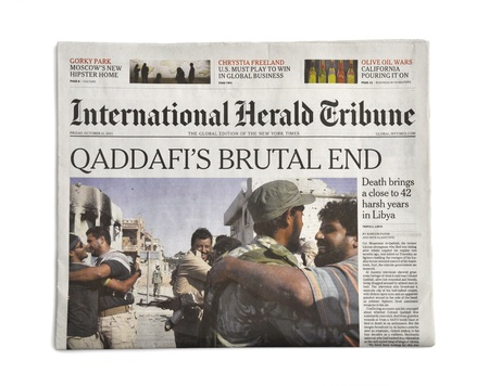 end times: LONDON - OCTOBER 20: Gaddafis death makes headlines in the press on October 20, 2011. Gaddafi was president of Libya for 42 years.
