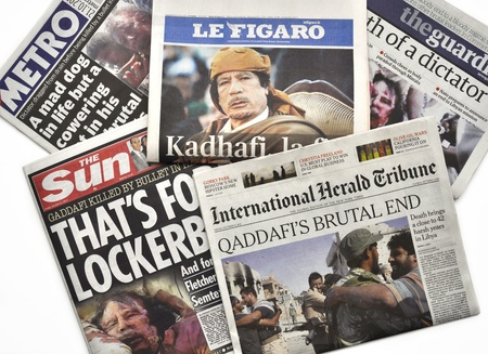arab spring: LONDON - OCTOBER 20: Gaddafis death makes headlines in the press on October 20, 2011. Gaddafi was president of Libya for 42 years.