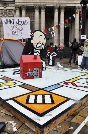 occupy london: LONDON - OCTOBER 27: Occupy London encampment outside St Pauls cathedral on October 27, 2011 in London. Occupy London is a peaceful demonstration against economic inequality and social injustice.