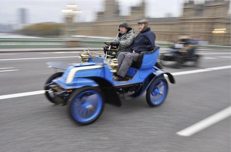 LONDON - NOVEMBER 06: London to Brighton Veteran Car Run participants crossing Westminster Bridge, on November 06, 2011 in London.