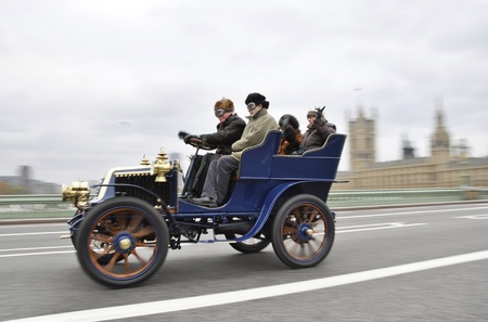 LONDON - NOVEMBER 06: London to Brighton Veteran Car Run participants crossing Westminster Bridge, on November 06, 2011 in London.