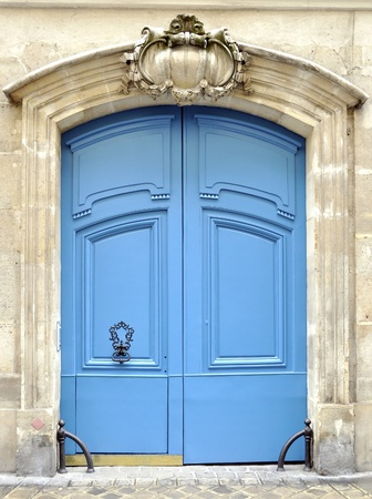 view of a wooden doorway: A blue door in Paris, France Stock Photo