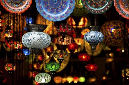 colorful lantern: Colorful Arabic lantern and plates in a souk Stock Photo