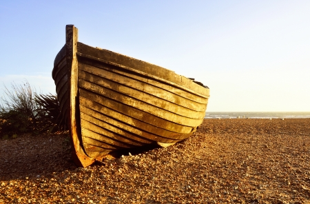Fisherman barque at sunset on Brighton beach, UK photo