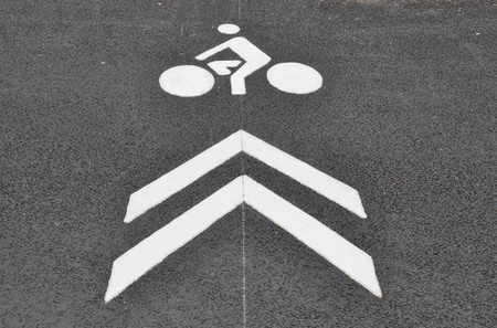White bicycle lane sign painted on asphalt photo