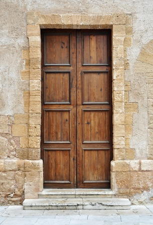 Vintage brown wooden door in Italy photo