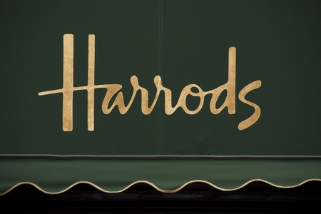 Harrods golden sign on green awning