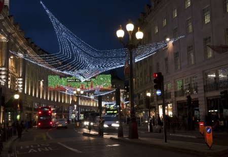 LONDON, UK - DECEMBER 13, 2011: The Christmas decorations are lit in Regent Street on December 13, 2011 in London.