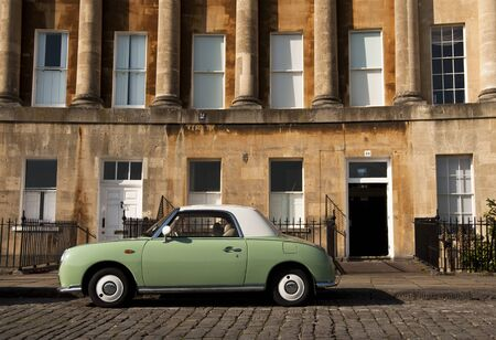 nissan: Bath, UK - OCTOBER 14, 2011: A Nissan Figaro in front of the Royal Crescent