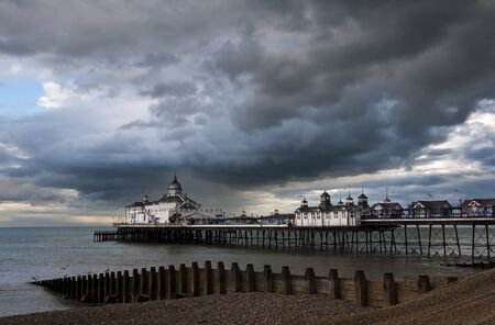 bad weather: Eastbourne Pier, cloudy sky , England, UK Stock Photo