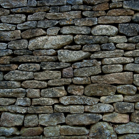 Old and weathered stone wall background, square photography Stock Photo - 12282976