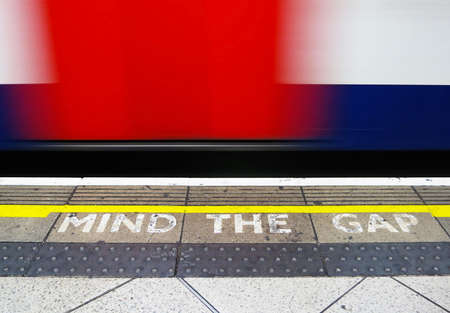 Mind the gap, warning in the London underground                                photo